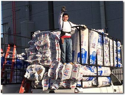 man standing on a truckload of insulation - RBH Insulation, El Segundo, CA